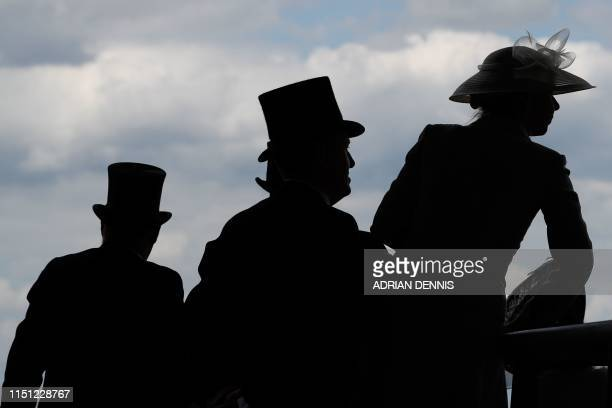 Racegoers watch the action from the royal enclosure on day four of the Royal Ascot horse racing meet, in Ascot, west of London, on June 21, 2019. -...