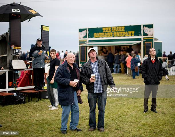 Racegoers watch the action on the big screen during the Laytown race meeting run on the beach on September 08 2011 in Laytown Ireland