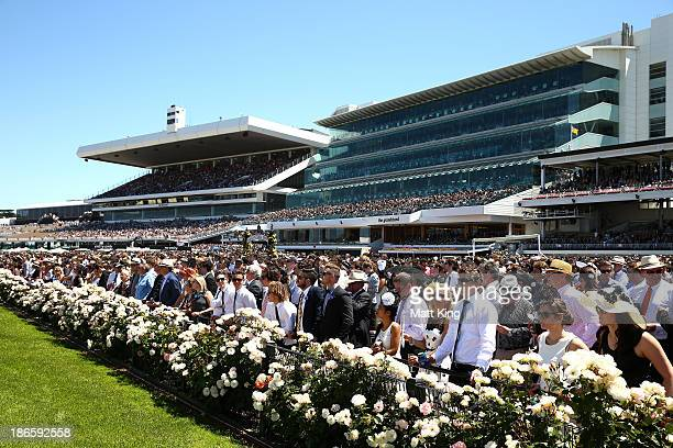 Racegoers watch the action on Victoria Derby Day at Flemington Racecourse on November 2 2013 in Melbourne Australia