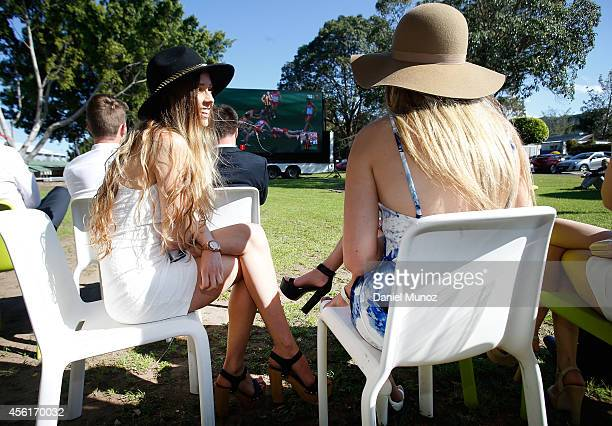 Racegoers watch the AFL grand final between Sydney Swans and hawthorn on a big screen during Sydney Racing at Rosehill Gardens on September 27 2014...