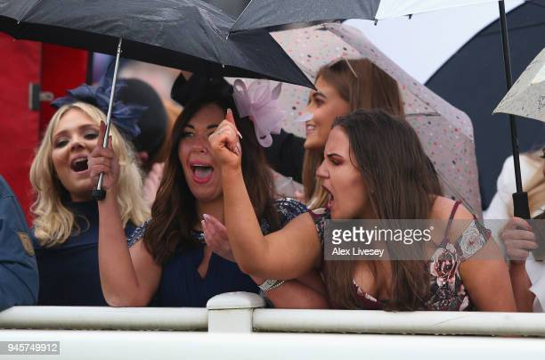 Racegoers watch the Alder Hey Children's Charity Handicap Hurdle Race on Ladies Day at Aintree Racecourse on April 13 2018 in Liverpool England