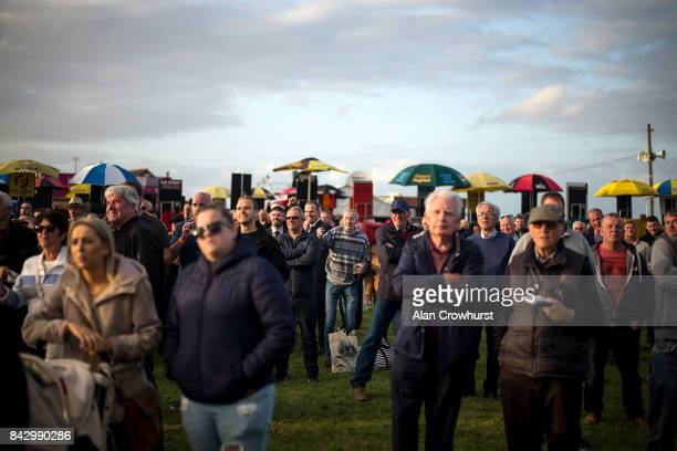 Racegoers watch the big screen at Laytown racecourse on September 5 2017 in Laytown Ireland Laytown racecourse is a horse racing venue run on the...