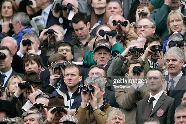 Racegoers watch the day's racing on the final day of Cheltenham Festival on March 16 2007 in Gloucestershire England