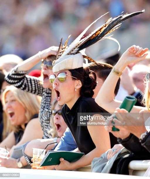 Racegoers watch the racing as they attend day 3 'Grand National Day' of the Randox Health Grand National Festival at Aintree Racecourse on April 8...