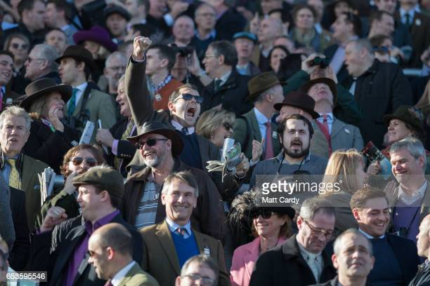Racegoers watch the racing at the Cheltenham Racecourse on Ladies Day the second day of the Cheltenham Festival on March 15 2017 in Cheltenham...