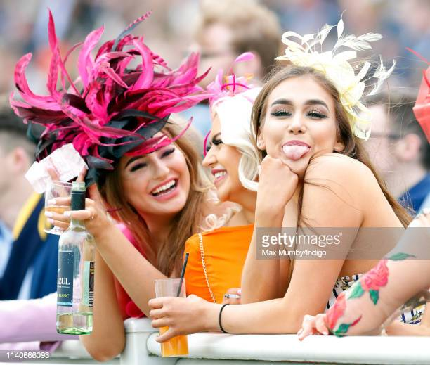 Racegoers watch the racing on day 2 'Ladies Day' of The Randox Health Grand National Festival at Aintree Racecourse on April 5, 2019 in Liverpool,...