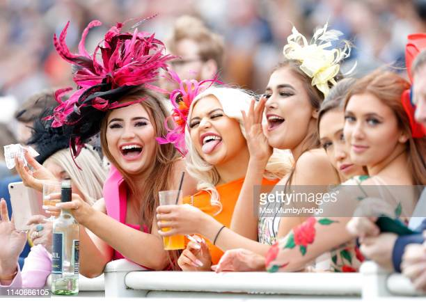 Racegoers watch the racing on day 2 'Ladies Day' of The Randox Health Grand National Festival at Aintree Racecourse on April 5 2019 in Liverpool...
