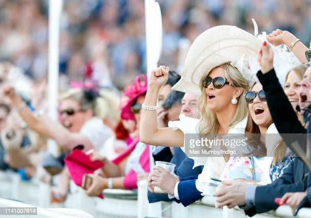 Racegoers watch the racing on day 3 'Grand National Day' of The Randox Health Grand National Festival at Aintree Racecourse on April 6 2019 in...