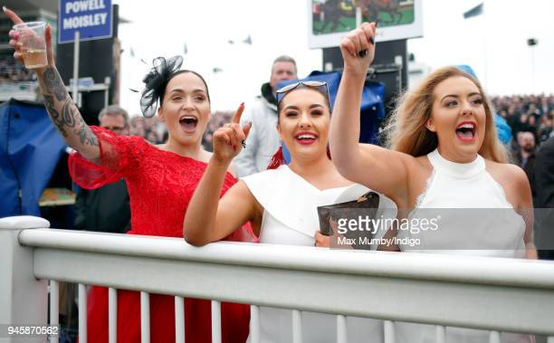 Racegoers watch the racing on day one of The Randox Health Grand National Festival at Aintree Racecourse on April 12 2018 in Liverpool England