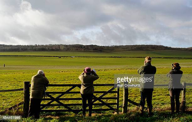 Racegoers watch the runners race down the far side of the track during the point to point meeting at Barbury Castle racecourse on December 08 2013 in...