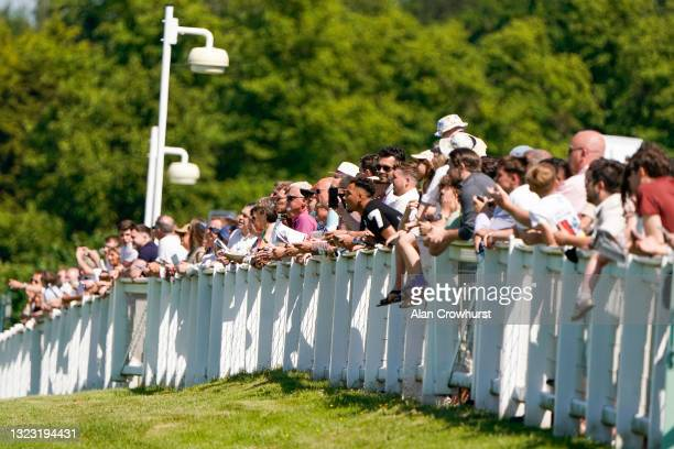 Racegoers watching the action at Sandown Park Racecourse on June 12, 2021 in Esher, England. Due to the Coronavirus pandemic, only owners along with...