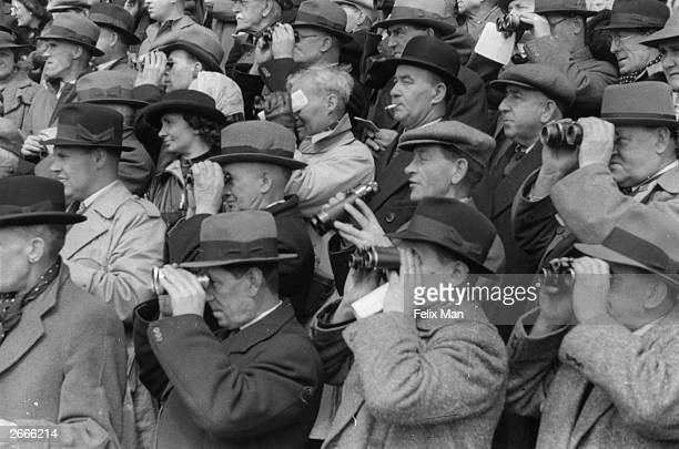 Racegoers watching the horseracing at Newmarket racecourse Original Publication Picture Post 292 Newmarket Prepares For The Derby pub 1939