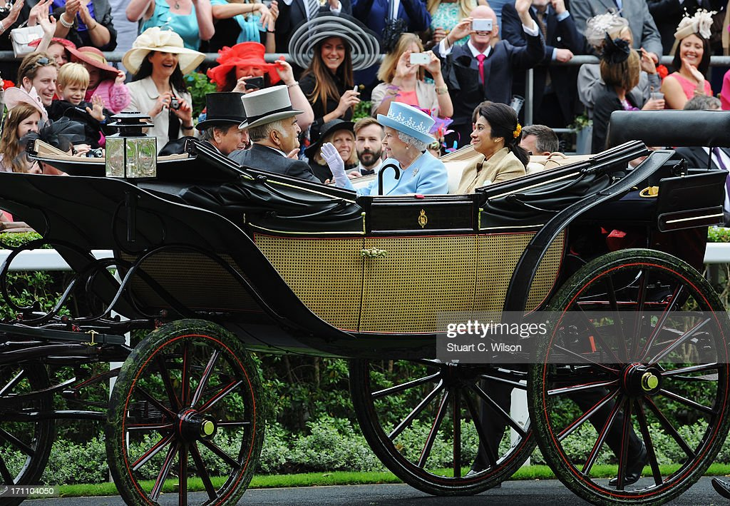 Racegoers wave at Queen Elizabeth II, Prince El Hassan Bin Talal, Princess Sarvath El Hassan and John Warren as they arrive with the Royal Procession on day five of Royal Ascot at Ascot Racecourse on June 22, 2013 in Ascot, England.