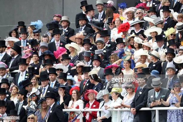 Racegoers wear fashionable hats as crowds gather during Royal Ascot Day 1 at Ascot Racecourse on June 19 2018 in Ascot United Kingdom