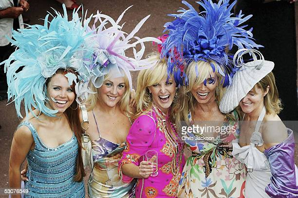 Racegoers wearing hats are seen on the third day of Royal Ascot 2005, Ladie's Day, at York Racecourse on June 16, 2005 in York, England. One of the...
