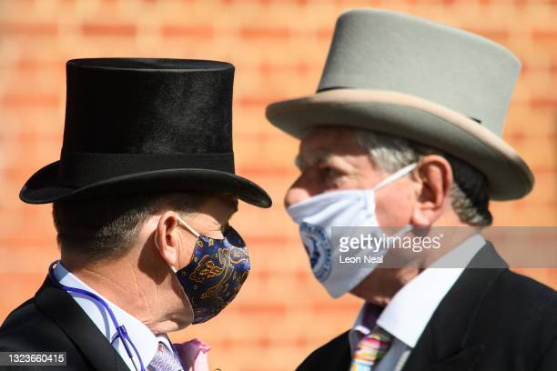 Race-goers wearing protective facial masks enter the grounds at Ascot Racecourse on June 15, 2021 in Ascot, England. 12,000 spectators are being...