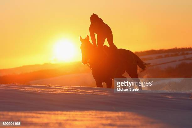 Racehorse and rider from the Fergal O'Brien stables during morning gallops on December 12 2017 in Naunton Gloucestershire