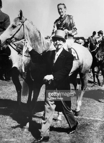 Racehorse owner E. C. S. Falconer leading his horse, Baghdad Note, ridden by jockey Midge Didham after their win in the Melbourne Cup at Flemington...