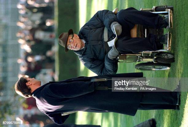 Racehorse trainer Dick Hern talks to Angus Gold racing manager to Sheik Hamdam at Newmarket today where he ended his 40year career in the Listed...