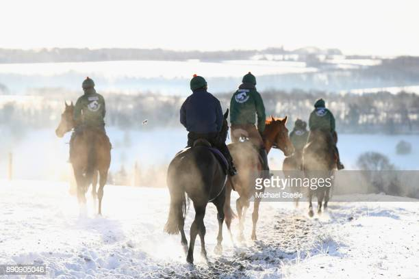 Racehorses workout in heavy snow conditions during the morning gallops at the yard of national hunt trainer Nigel TwistonDavies on December 12 2017...
