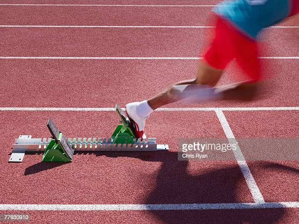racer at start line on track - forward athlete stock pictures, royalty-free photos & images