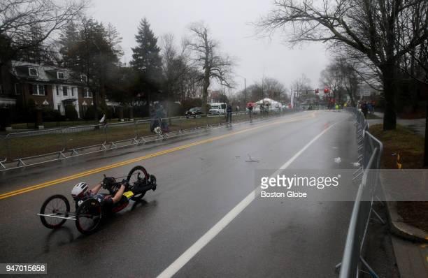 A racer climbs Heartbreak Hill during the Boston Marathon in Newton Mass April 16 2018