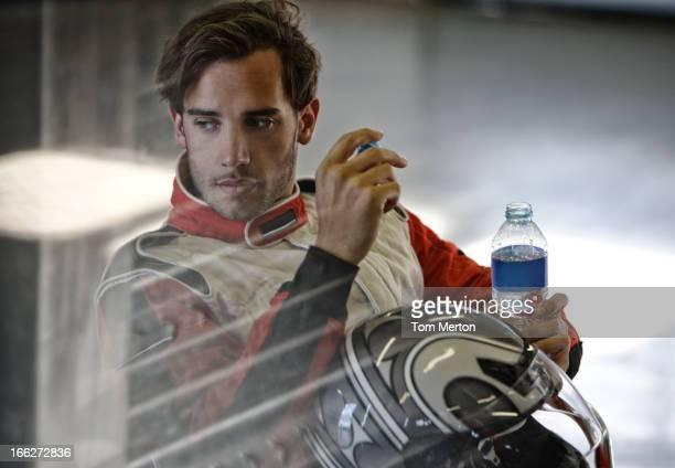 Racer drinking bottle of water