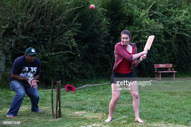 BMX racer Sarah Walker plays a shot during a backyard cricket match captained by Kiwi cricket greats Sir Richard Hadlee and Stephen Fleming under the...