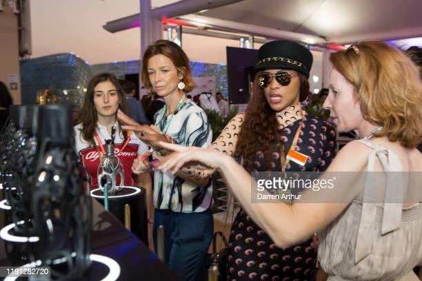 F2 racer Tatiana Calderón and American rap artist Eve at the launch of the F1 fragrance at the Formula 1 Etihad Airways Grand Prix Yas Marina Circuit...