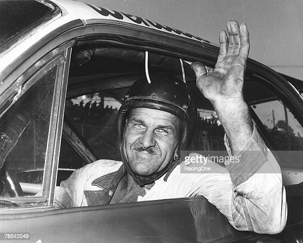 Racer Wendell Scott waves from his car, Jacksonville, Florida, December 1, 1963. On this day, he won the 200-mile event at Jacksonville Speedway, his...