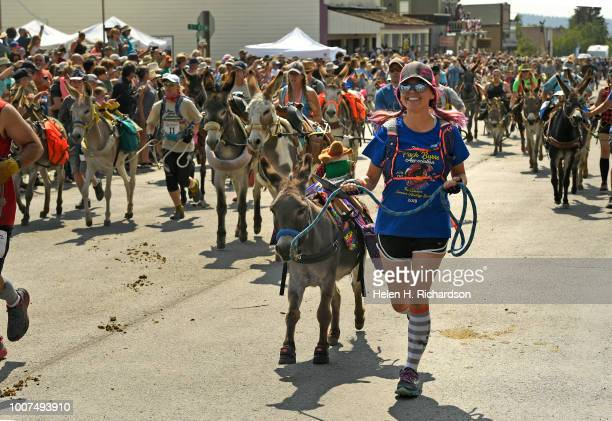 Racers and their donkeys take off up Front Street as they begin the 70th annual World Championship Pack Burro Race on July 29 in Fairplay Colorado...