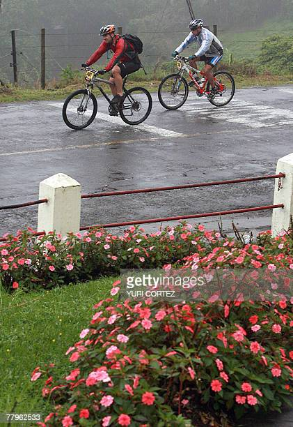 Racers are seen during the last stage of the Route of Conquerors mountain bike race 17 November 2007 in Playa Bonita Limon province some 120...