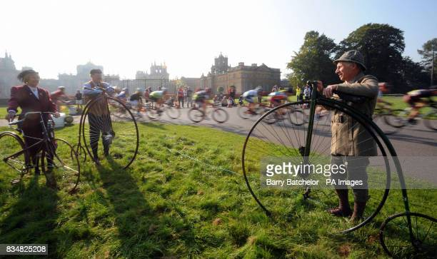 Racers at the Bike Blenheim Palace event pass members of the Benson Veteran Cycle Club Sandra Catherall with a 1887 Peugeot solid tyred safety...