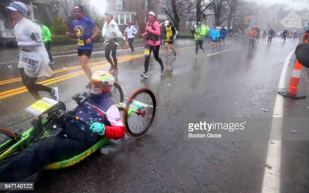 Racers crest Heartbreak Hill during the Boston Marathon in Newton Mass April 16 2018