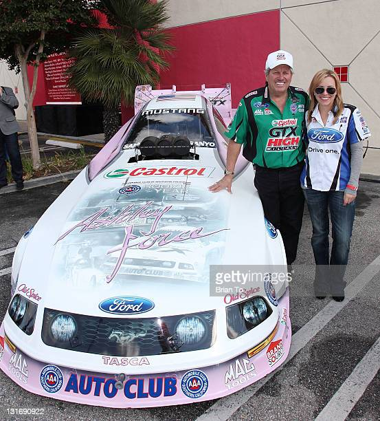 Racers John Force and Brittany Force attend Yahoo Sports presents A Day of Champions at Sports Museum of Los Angeles on November 6 2011 in Los...
