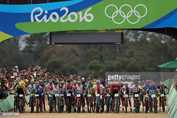Racers line up before the start of the Women's CrossCountry Mountain Bike Race on Day 15 of the Rio 2016 Olympic Games at the Mountain Bike Centre on...