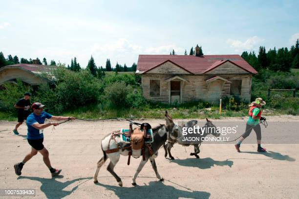 Racers pass by the remains of the Denver South Park and Pacific train depot from the 1890's during the 70th Annual Burro Days Race in Fairplay...