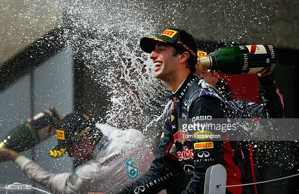 Racewinner Daniel Ricciardo of Australia and Infiniti Red Bull Racing is sprayed with champagne by teammate Sebastian Vettel of Germany and Infiniti...