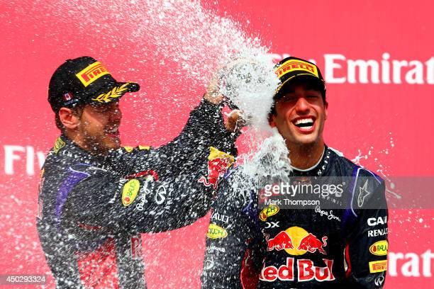 Racewinner Daniel Ricciardo of Australia and Infiniti Red Bull Racing is sprayed with champagne by teammate Sebastian Vettel of Germany and Infiniti...
