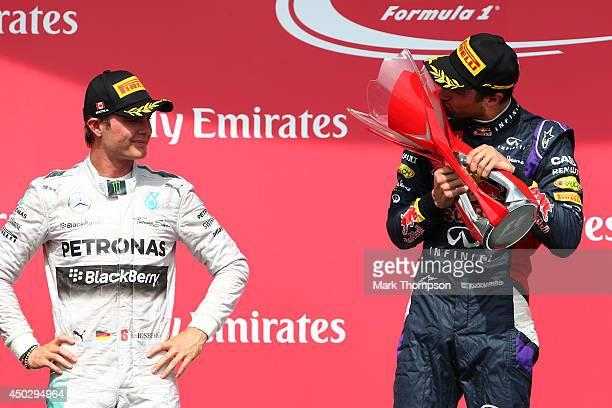 Racewinner Daniel Ricciardo of Australia and Infiniti Red Bull Racing kisses the trophy following his first Grand Prix victory Adrian Sutil of...