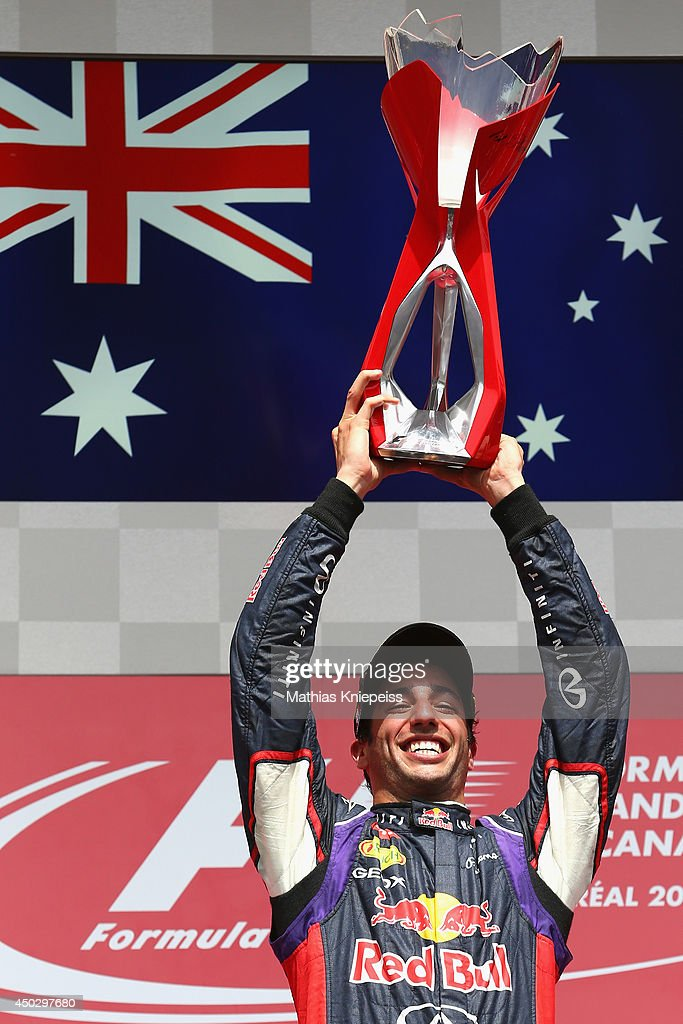 Racewinner Daniel Ricciardo of Australia and Infiniti Red Bull Racing lifts the trophy following his victory during the Canadian Formula One Grand Prix at Circuit Gilles Villeneuve on June 8, 2014 in Montreal, Canada.