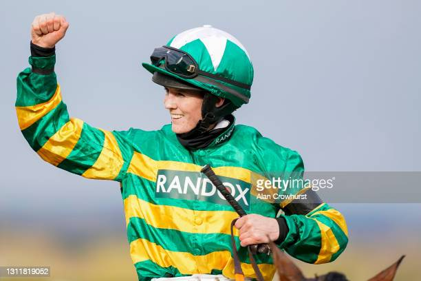 Rachael Blackmore celebrates after riding Minella Times to win The Randox Grand National Handicap Chase at Aintree Racecourse on April 10, 2021 in...