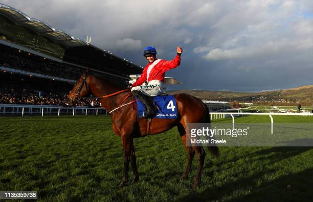 Rachael Blackmore celebrates as she rides A Plus Tard to victory during the Close Brothers Novices' Handicap Chase on Champion Day of the Cheltenham...