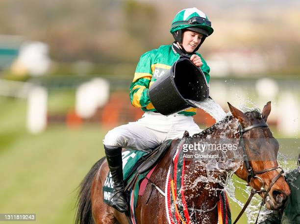 Rachael Blackmore cools down Minella Times after winning The Randox Grand National Handicap Chase at Aintree Racecourse on April 10, 2021 in...