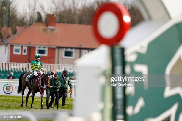 Rachael Blackmore returns after riding Minella Times to win The Randox Grand National Handicap Chase at Aintree Racecourse on April 10, 2021 in...