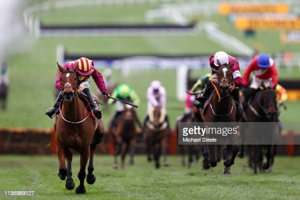 Rachael Blackmore rides Minella Indo towards victory in the The Albert Bartlett Novices' Hurdle Race during the Gold Cup Day at Cheltenham Festival...