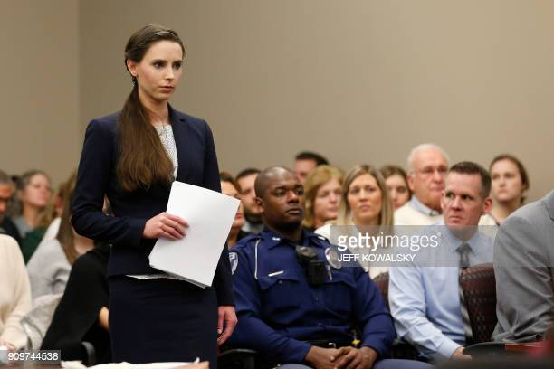 Rachael Denhollander speaks as former Michigan State University and USA Gymnastics doctor Larry Nassar listens to impact statements during the...