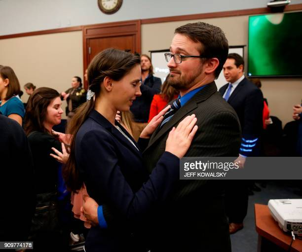 Rachael Denhollander who was victimized by former Former Michigan State University and USA Gymnastics doctor Larry Nassar is consoled by her husband...