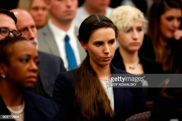 Rachael Denhollander who was victimized by former Michigan State University and USA Gymnastics doctor Larry Nassar listens during the sentencing...