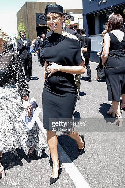 Rachael Finch arrives poses on Derby Day at Flemington Racecourse on October 29 2016 in Melbourne Australia
